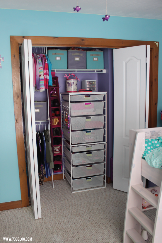 Child's Closet Organized with bins and a set of Custom Elfa Drawers