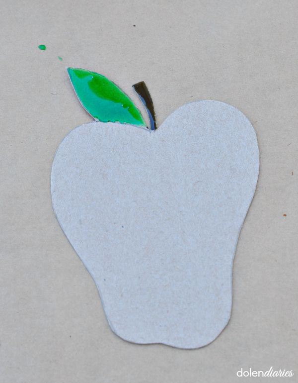 painting cardboard apple stem and leaf with corn syrup paint