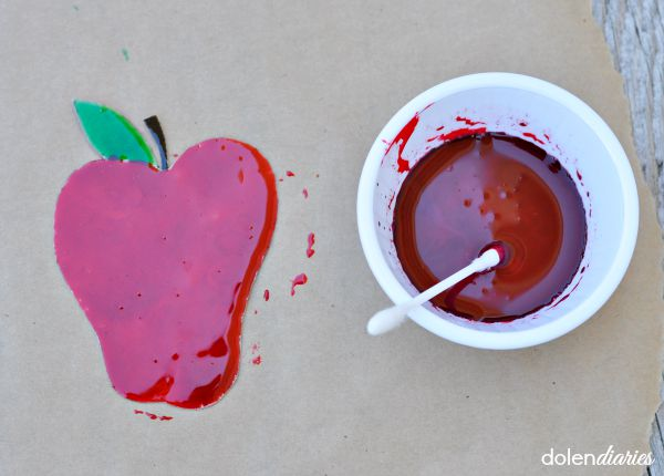 painting cardboard apple with glossy corn syrup paint