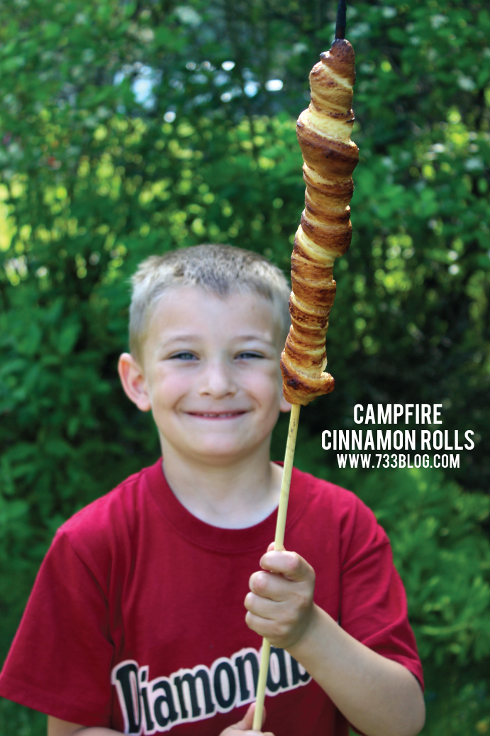 Cinnamon Rolls on a Stick over a Campfire