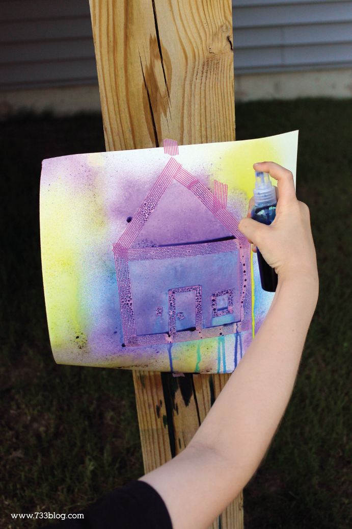 Spray Bottle Painting - get the kids outside with this fun painting and tape resistance technique!