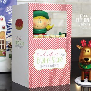 """Free Printable Elf on the Shelf Bake Sale Stand - add some delicious """"Cheerios"""" Donuts to complete the stand!"""