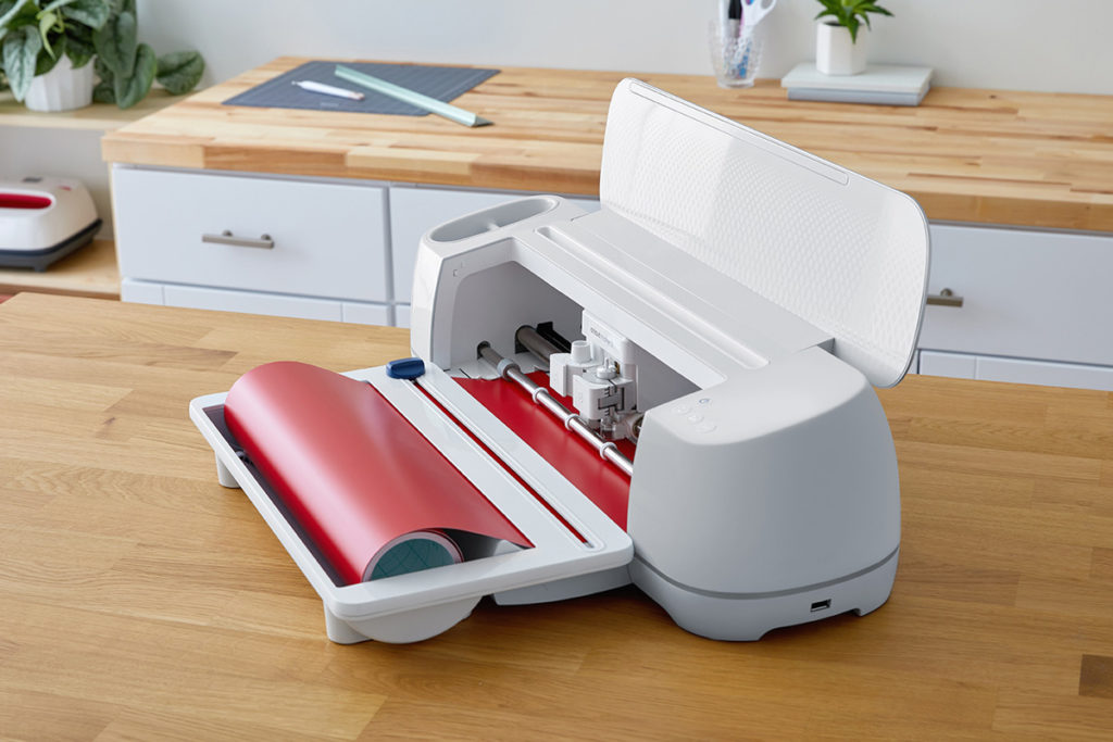 Cricut Maker 3 shown with Roll Holder and Smart Material Vinyl